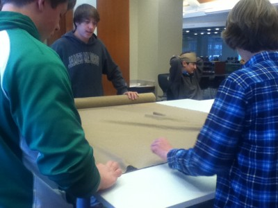 Students prepare to cut the linen.